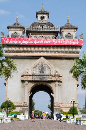 literally: Big red billboard campaign for Lao Peoples Revolutionary Party 10th installed on top of Patuxai literally meaning Victory Gate. Vientiane, Laos on January 15, 2016