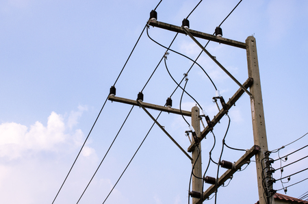 cable tangle: Electrical wires on blue sky background - Bangkok, Thailand Stock Photo