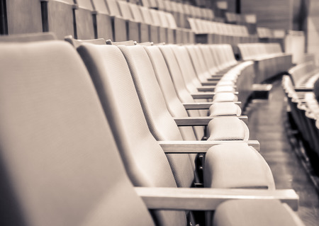 duo tone: Duo tone color image Close up and selective focus of Empty rows of armchairs in hall