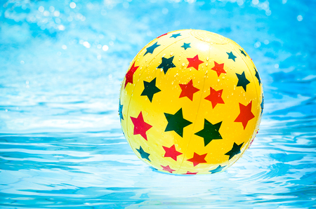 furlough: Retro look filter and selective focus  Inflatable ball floating in swimming pool
