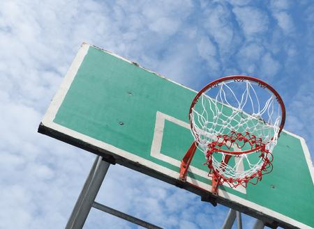 Street basketball, Wooden basket hoop on blue sky, Close up image Stock Photo
