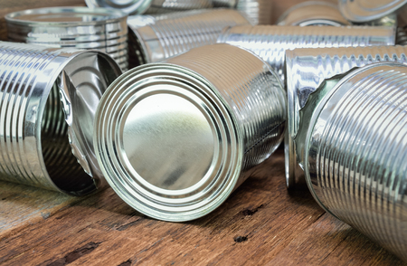 tinned goods: Tin cans for food on wooden background