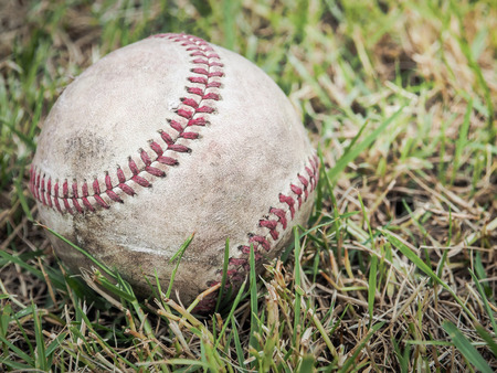 play the old park: Nostalgic baseball in the grass on a baseball field, Selective focus and close up