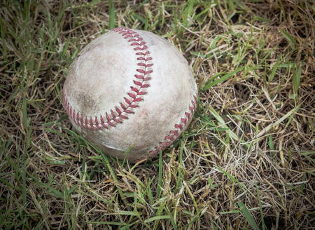 outfield: Nostalgic baseball in the grass on a baseball field, Selective focus and close up