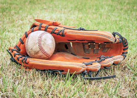 Nostalgic baseball in glove on a baseball field, Close up image Stock Photo