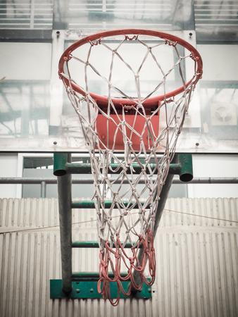 sport hall: Basketball Hoop in Sport Hall, Retro color filter