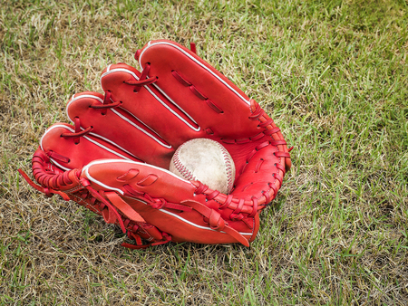 outfield: Nostalgic baseball in glove on a baseball field, With place your text Stock Photo