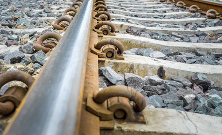 long way: railroad metal with concrete with track bed Stock Photo