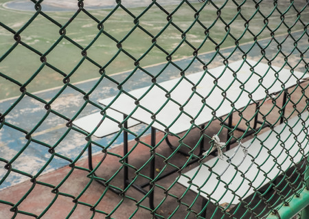 wired: Color retro image, Outdoor sport court behind Green wired fence