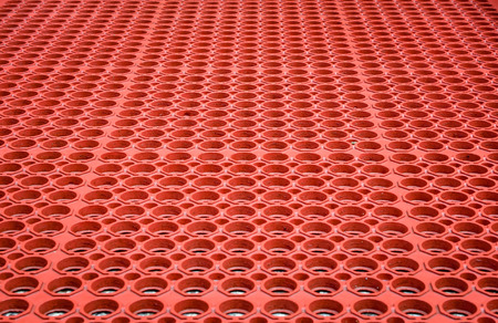 perforated: Abstract red perforated plastic background