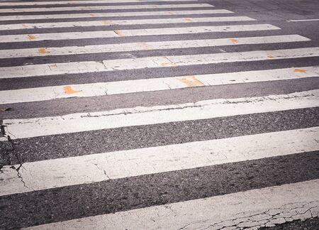 crosswalk: Cracked asphalt crosswalk, pedestrian crossing  Transportation concept