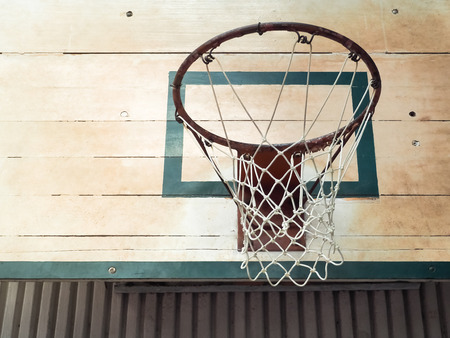 sport hall: Basketball Hoop in Sport Hall with place your text, Retro color filter