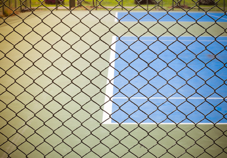 wired: Outdoor tennis sport court behind wired fence, Color retro image for background Stock Photo