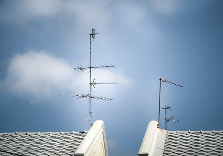 silhouetted: Old antenna for television with blue sky background, Silhouetted image