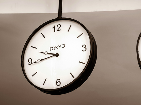 日本: An airport clock showing Tokyo time zone at 9 past 45, Retro filter color 写真素材