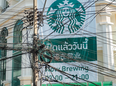 BANGKOK: January 11: The Chaos of Cables and Wires Located on Starbucks Coffee Shop in Chinatown on JANUARY 11, 2017 in Bangkok, Thailand.