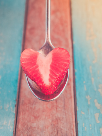 strawberrys: Retro filter, Strawberrys heart served for love. Love concept