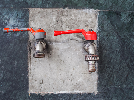 mounted: Old faucets are mounted on the wall. Selective focus