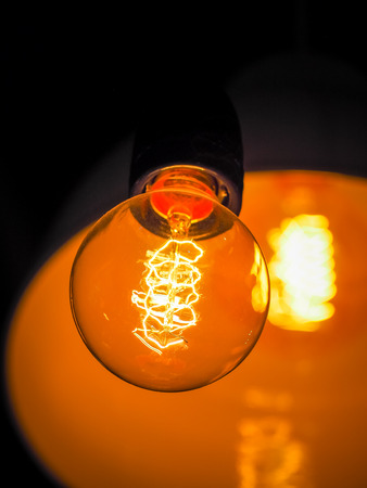 Vintage glowing light bulb, Close up and selective focus (light bulb, light, lamp) Stock Photo