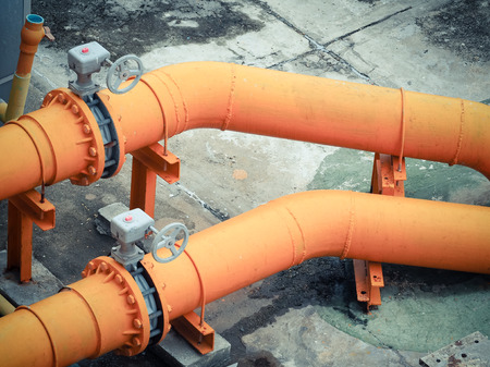 Orange water pipes installed on high buildings.or factory Stock Photo
