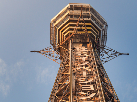 OSAKA, Japan - April 4, 2017 : Tsutenkaku Tower in Shinsekai district with blue sky. The current tower is the second to occupy the site after the first was destroyed by fire in 1943. Editorial