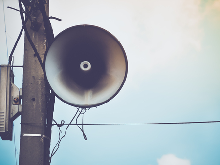 Retro speaker on blue sky (speaker, announcement, sound)