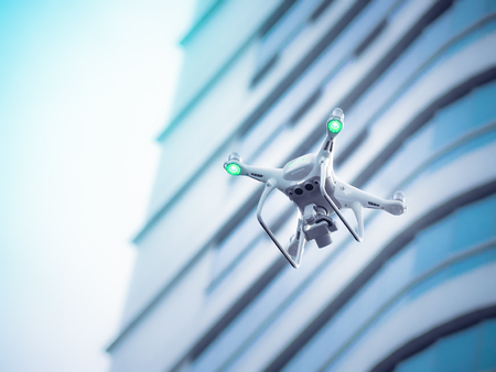 Drone with high resolution digital camera flying in the city. 스톡 콘텐츠