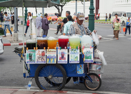 BANGKOK, THAILAND - June 24th, 2018 : Street vendor cart selling ice fruit juices, Which are commonly seen in the streets of Bangkok. Thailand.