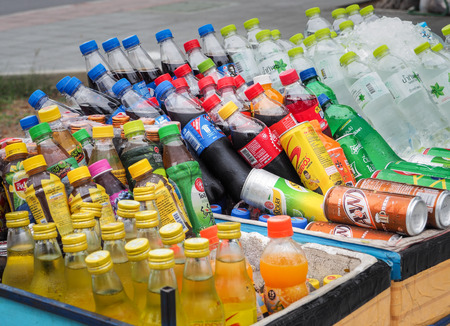 BANGKOK, THAILAND - June 24th, 2018 : Street vendor cart selling variety of cold energy drinks, soft drinks, bottled juice and sport drinks. Which are commonly seen in the streets of Bangkok. Thailand.