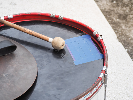 Retro percussion musical instrument. Military drum (Bass drum) with drum sticks.