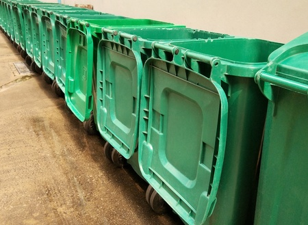 Rows of green plastic recycling bin. Image for environment concept. Stock Photo