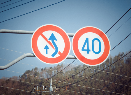 Traffic sign not overtaking and speed limit on the highway in Japan.