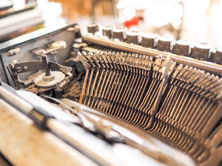 Close up of old thai alphabet typewriting machine. Conceptual image publishing, blogging, author or writing. Antique Typewriter.