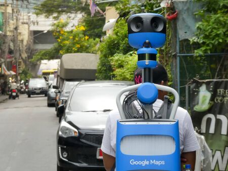BANGKOK, THAILAND - May 16, 2019: Officials survey from Google company used hi-tech machine by walking for Street View survey, On duty to determine the GPS satellite in street and alley for Google map application. Editorial