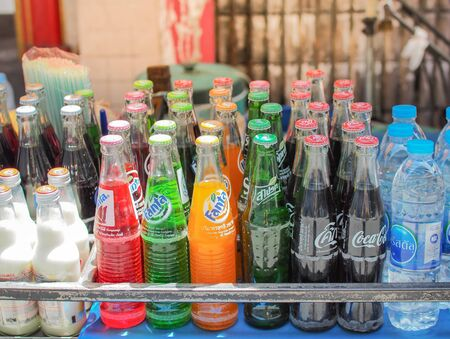 BANGKOK, THAILAND - June 24th, 2019 : Street vendor cart selling variety of cold energy drinks, soft drinks, bottled juice and sport drinks. Which are commonly seen in the streets of Bangkok. Thailand.