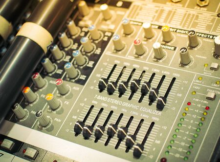 Sound equalizer mixing. Professional studio equipment for sound mixing. Music studio image. Close up and selective focus.