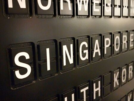 Signs name of Singapore country on black directory board. Used for For currency exchange, airport, business, finance or travel concept, Signs and symbols.