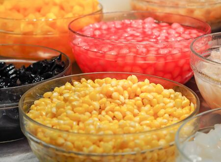 Sweet tropical corn with syrup in glass bowl. Thai dessert (ruam mit)