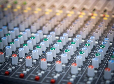 Sound equalizer mixing. Professional studio equipment for sound mixing. Music studio image. Close up and selective focus. Stock Photo
