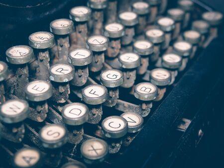 Close up of vintage fashioned typewriting machine. Conceptual image publishing, blogging, author or writing.