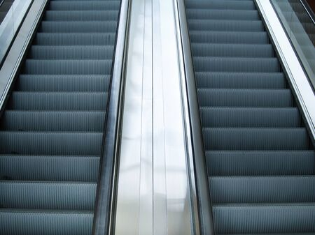 Empty escalator stairs in subway station or shopping mall, Modern escalators in an office building.