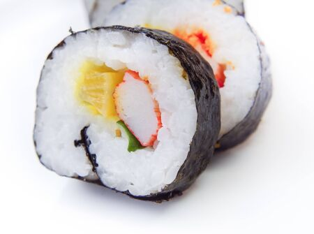 Maki rolls (Sushi roll with rice and nori) on white background. Japanese food.