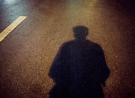 Shadow of a men on street concrete background at night, Shadow of strangers with place your text. Banque d'images