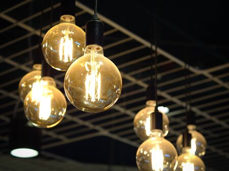Glowing light bulb hanging from the ceiling restroom background. Interiors objects.