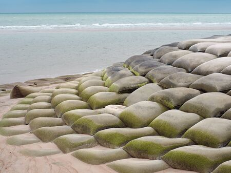 Sand bags or sandbagger installed for protect the collapse of the beach, The concept for the conservation of Nature. Reklamní fotografie