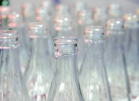 Many used glass bottles arranged in rows. Close up and selective focus of empty soda bottles, Recyclable object image. Standard-Bild
