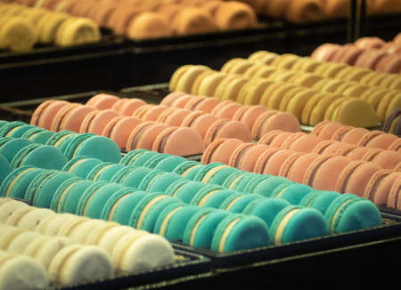 Colorful tasty macaroons. Sweet almond cookies macrons. Close up and Selective focus of french sweet delicacy. Standard-Bild