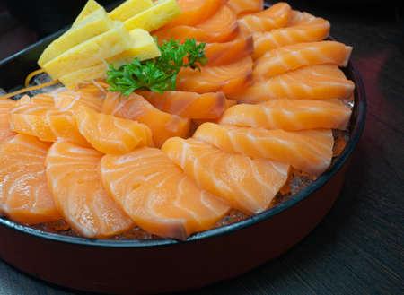 Fresh Sashimi Salmon Fillet with tamakoyaki In a Bowl. Japanese Dish.