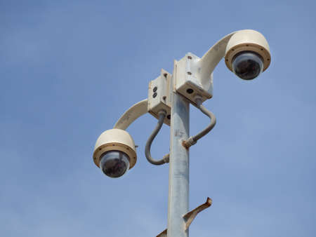 360 Degree fish eye dome CCTV is installed on column against blue sky. CCTV for security monitoring