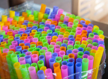 Colorful plastic drink straws for beverage or juice. Close up and selective focus.